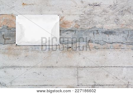 Old Blank Metal Plate On Concrete Wall