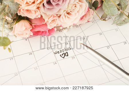 Word Wedding And Two Hearts On Calendar With Sweet Rose Bouquet. Love, Invitation, Advertisement, Ro