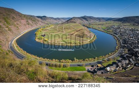 Panoramic View Of Ship On Famous Moselle River At Moselschleife With The Historic Town Of Bremm On A