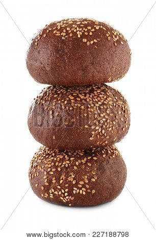 Tasty rye buns with sesame seeds isolated on white