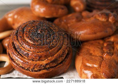 Tasty sweet buns on table, closeup