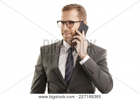 Middle Aged Happy Male Business Broker Using Mobile Phone And Making Call. Isolated On White Backgro