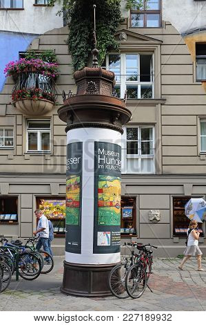 Vienna, Austria - July 12, 2015: Kunst Haus Museum Column In Front Of Famous Organic Apartment Build