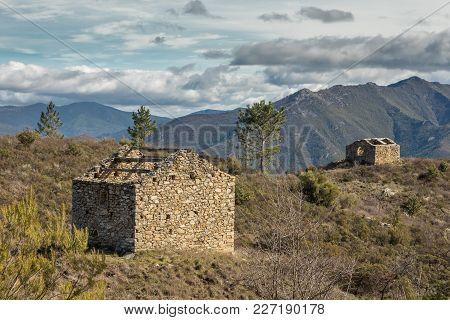 Two Derelict Stone Buidings In Mountains Near Venaco In Corsica