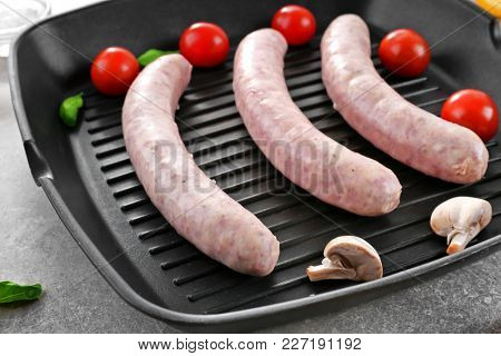 Grill pan with delicious sausages, closeup