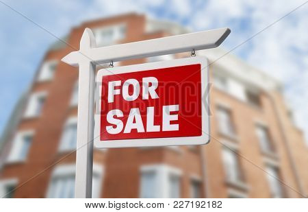 Sign FOR SALE in front of modern apartment house outdoors. Real estate market