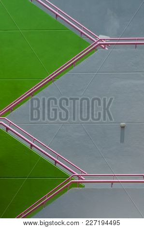 External Building Stair Way Painted In Green And Grey With Pink Railing Present A Repeat Pattern