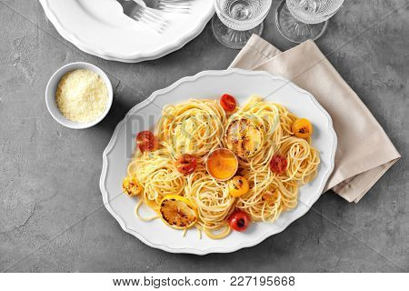 Delicious pasta with egg yolk and vegetables on plate