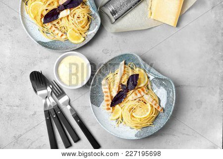 Delicious pasta with chicken served for dinner on table