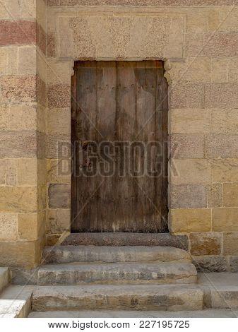 Grunge Wooden Aged Door On Exterior Stone Bricks Wall Of Amir Aqsunqur Mosque (blue Mosque), Medieva