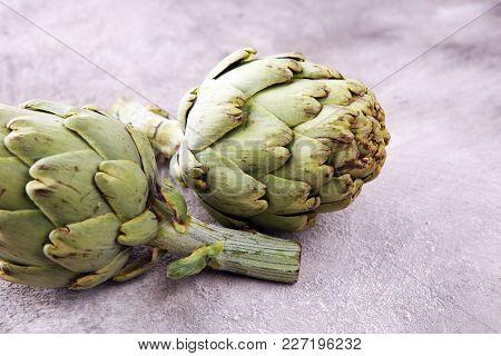 Artichokes On Grey Background. Fresh Organic Artichoke Flower