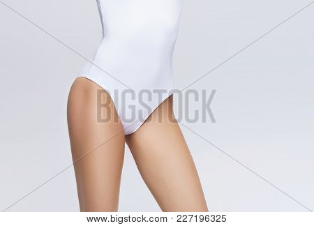 Sporty And Sexy Female Body. Liposuction, Nutrition, Weight Loss And Dieting Concept.