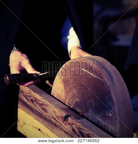 Elder Knife Sharpener Sharpens His Knife With Vintage Effect