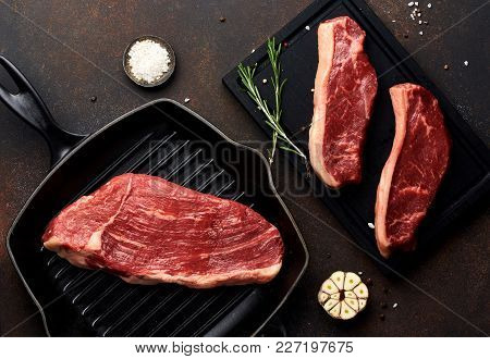 Raw Fresh Meat Picanha Steak, Traditional Brazilian Cut With Thyme, Garlic, And Black Pepper On Wood