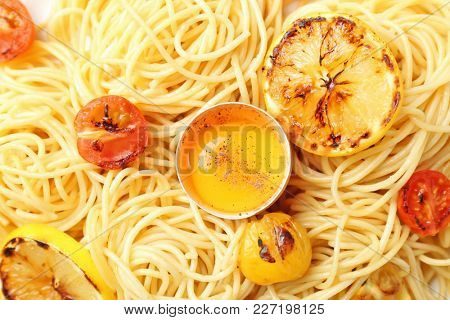 Delicious pasta with egg yolk and vegetables, closeup