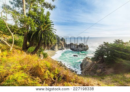 Mcway Falls In Big Sur State Park Under A Blue Sky. California, Usa