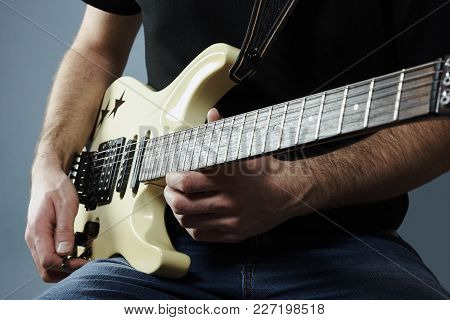 Hands Of A Young Man Holding A Electric Guitar