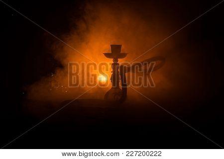 Hookah Hot Coals On Shisha Bowl With Black Background. Stylish Oriental Shisha. Shisha Concept