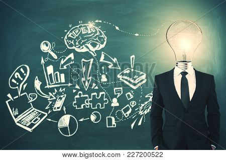 Light Bulb Headed Businessman With Business Sketch. Idea And Marketing Concept