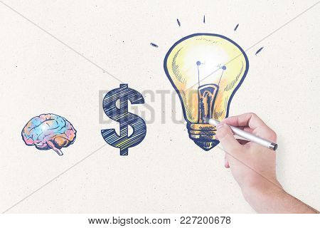 Male Hand Drawing Creative Business Sketch On Concrete Wall Background. Idea And Workshop Concept