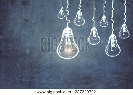 Creative Lamp Sketch On Concrete Wall Background. Idea, Innovation And Imagination Concept