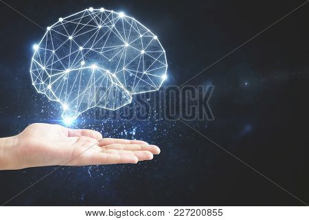 Hand Holding Glowing Polygonal Brain On Dark Background. Artificial Intelligence And Mind Concept. 3