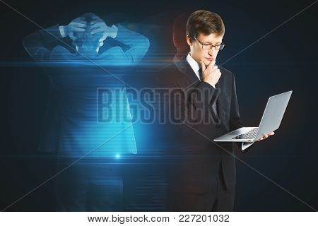 Businessman With Laptop And Abstract Hologram. Future And Hi-tech Concept. 3d Rendering