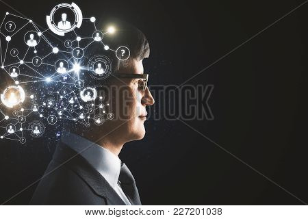 Digital Business Hologram Headed Businessman On Dark Background With Copyspace. Face Recognition And