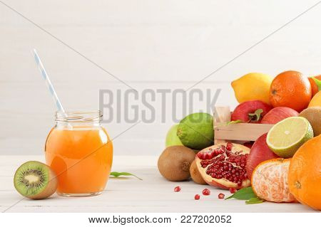 Juice And Fruits On Background. Healthy Lifestyle. A Glass Of Freshly Squeezed Juice On The Backgrou