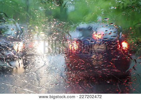 Rush hour traffic in heavy rainy weather