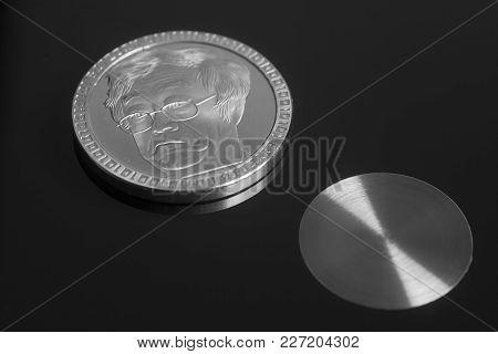 Silver Bitcoin Virtual Coin On A Black.