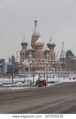 St. Basil's Cathedral On Red Square In Moscow Covered With Snow To The Domes.