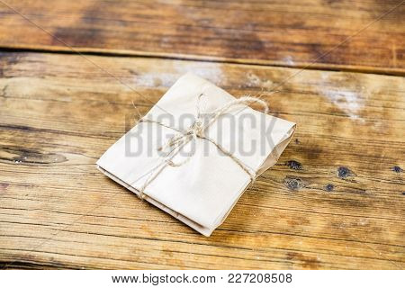 Close-up Gift Wrapped Kraft Paper On Wooden Background