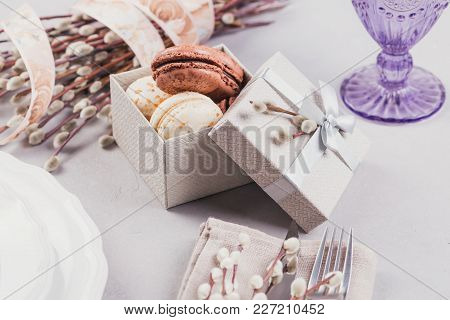 Easter Table Setting. White Plate, Purple Glass, Cutlery, Present Box With Macaroons And Pussy Willo