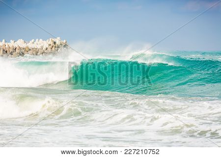Waves In Ocean And Stones. Turquoise Water