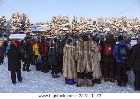 Jokkmokk, Sweden On February 03. View Of Well-dressed Spectators From Behind On February 03, 2018 In