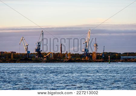 Old Crane With Rusty Metal Rails Near Sea Port