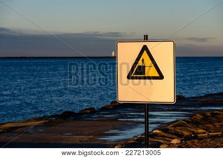 Attention Signs Near Sea With Stormy Weather