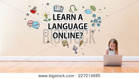 Learn A Language Online Text With Little Girl Using A Laptop Computer On Floor