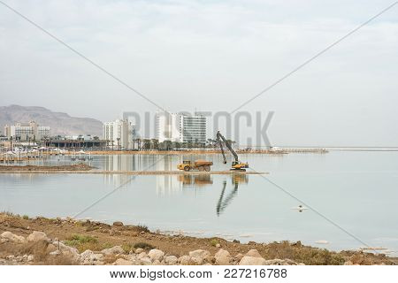 Excavator In The Development And Construction The Dead Sea, Climate Change And The Draining Of The D