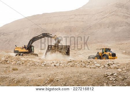 Excavator In The Development And Construction In The Mountains