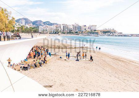 Benidorm, Spain, January 29, 2018: People Doing Exercises On The Beach. Healthy Lifestyle, Active Li