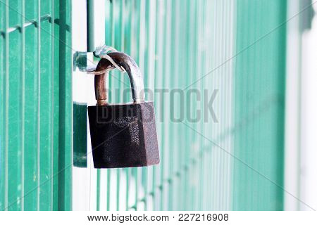 A Rusty Chain On A Weathered Metal Door With A Padlock, Object