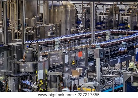 Conveyor Belt Of Brewery Production Line . Beer Bottles Are Moving On Conveyor.