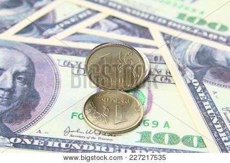 Coin One Ruble Against The Background Us Dollars Background