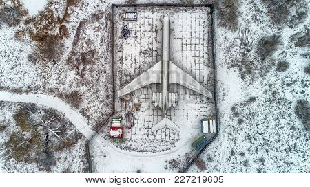 Aerial View Of A Plane That Is Located In A Parking Lot In The Forest In Winter. Hdr