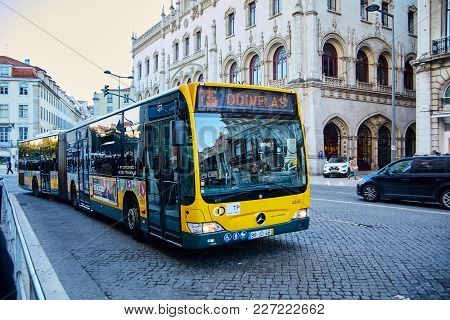 Lisbon, Portugal - January, 2018. The Yellow Mercedes Bus Goes On Route 136 To The Suburb Of Lisbon