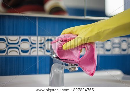 Housewife Work, A Housewife Doing Her Job, Cleaning Her Bathroom In The Bathroom, Gloves On Her Hand
