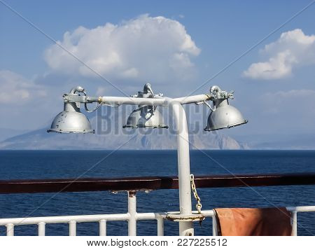 A Beautiful Summer Sea View From A Ship Deck. There Is A Deck Lamp In Foreground And A Dark Blue Sea