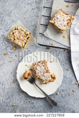 Sweet Piece Of Cake Pie With Fruit Jam And Streusel In White Plate On Light Background. Tasty Homema